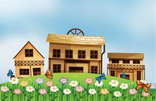 Drie verschillende houten huizen op de heuvel