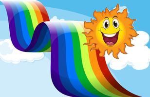 Een vrolijke zon dichtbij de regenboog