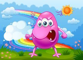 Een boos monster met een regenboog aan de hemel