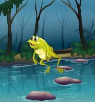 Een kikker die bij de vijver binnen het bos springt