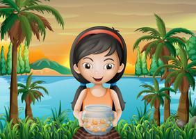 Een meisje met een aquarium vector