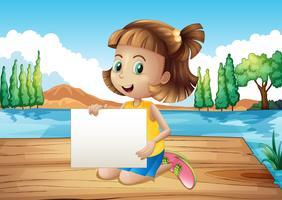 Een meisje bij de zeehaven met lege signage