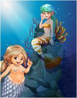 Twee zeemeerminnen onder de zee