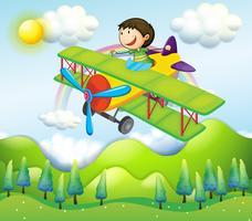 Een jonge man rijdt in een kleurrijk vliegtuig