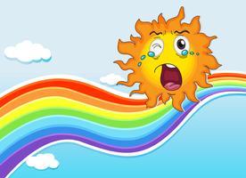 Een regenboog en een huilende zon
