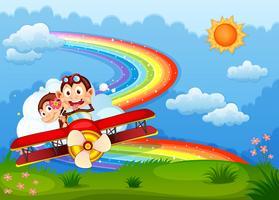 Een vliegtuig met twee opschepperige apen en een regenboog in de lucht