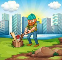 Een man hakkend hout over de hoge gebouwen