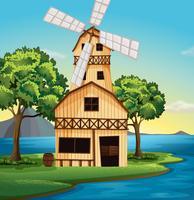 Een boerderij met een windmolen