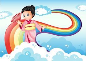 Een dame die een kimono draagt die bij de regenboog staat