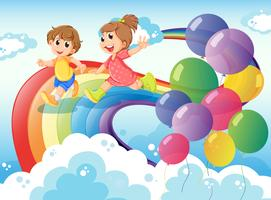 Kinderen spelen met de regenboog in de lucht
