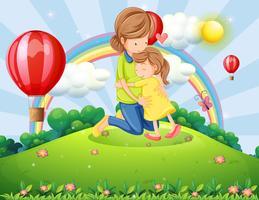 Een heuveltop met een moeder en een dochter