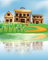 Een vijver met een weerspiegeling van de houten huizen
