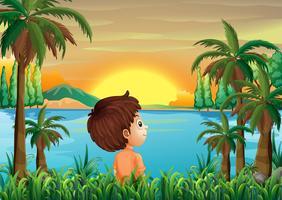 Een jongen in de buurt van de rivier
