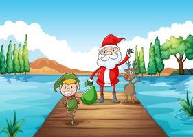 een jongen, een kerstman en een rendier