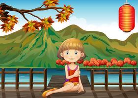 Een vrouw in de houten haven