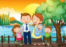Een gelukkig gezin op de houten brug