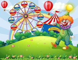 Een heuveltop met een clown en een pretpark