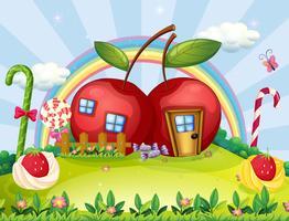 Een heuveltop met twee appelhuizen en een regenboog