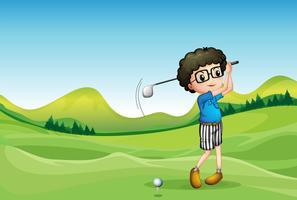 Een jongen golfen