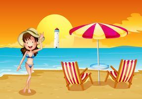 Een meisje op het strand aan de overkant van de vuurtoren vector