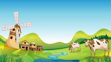 Een boerderij met een schuur en koeien
