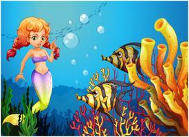 Een zeemeermin die de twee vissen bekijkt