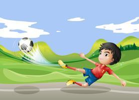 Een speler die op straat voetbalt