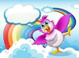 Een vogel in de lucht dichtbij de regenboog met een lege callout