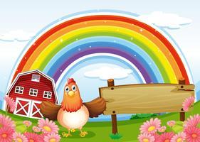 Een boerderij met een leeg houten bord en een regenboog erboven
