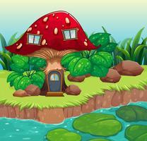 Een rood houten paddestoelhuis