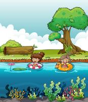 Twee meisjes aan de rivier