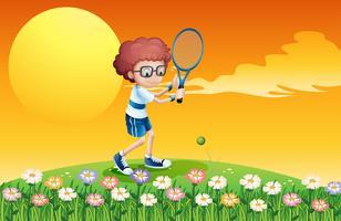 Een jongen met tennis op de heuvel