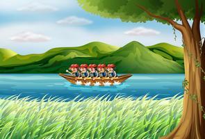 Een groep jongens die op een boot rijden