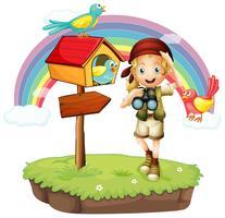 Een meisje met een telescoop met drie vogels