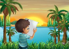 Een jongen met een krant aan de rivieroever