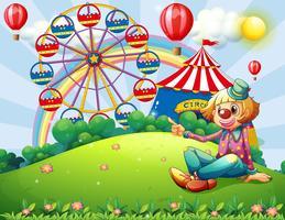 Een clown op de heuveltop met een carnaval