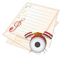 Een leeg muziekpapier met een trommel