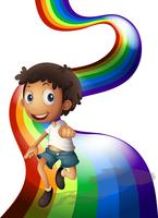 Een jongen die boven de regenboog danst