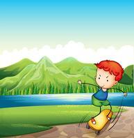 Een jonge man skateboarden op de rivieroever