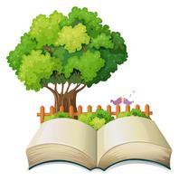 Een leeg open boek en een boom met een hek