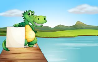 Een alligator die een leeg raad houdt bij de houten brug