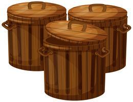 Drie houten emmers met deksels