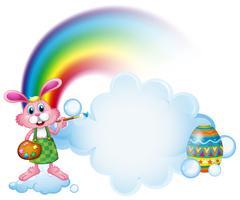 Een konijntje dat dichtbij de regenboog schildert