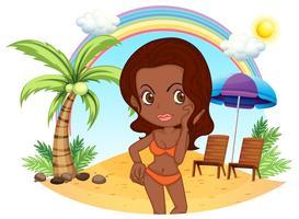 Een bruine dame in een oranje bikini op het strand