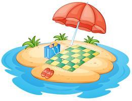 Een eiland met een paraplu en een deken