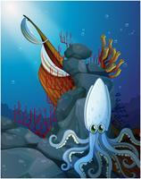 Een octopus onder het overzees dichtbij de houten boot