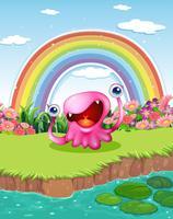 Een monster in de vijver met een regenboog in de lucht