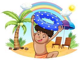 Een jonge jongen die geniet van op het strand vector