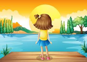 Een meisje dat op de zonsondergang let