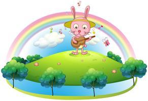 Een konijn speelt met de gitaar in de heuvel